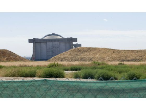 Acres of open space, mounds of dirt and weeds surround the south blimp hangar at Tustin.2010 Photo Jebb Harris OC Register