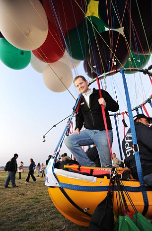 Jonathan Trappe poses in his cluster balloon craft before he took it out for a test run in Mexico Photo:   DailyMail.co.uk
