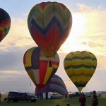Dozens of balloons were launched from High River
