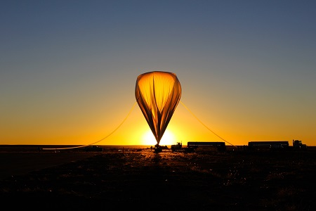 The high-altitude balloon that carried the HySICS instruments to the outermost part of Earth's atmosphere was inflated with helium at sunrise on the morning of Sept. 29, 2013. Photo: HySICS Team/LASP