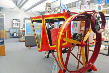 "One of the more unusual gondolas on display at the National Balloon Museum is the Cameron, a two-seat version that was used with the hot air airship ""St. Louis"". The balloon envelope is shaped like a blimp. Photo: Terry Turner"