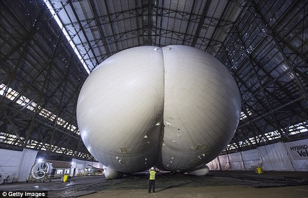 The world's longest aircraft - part airship, plane and helicopter - has been unveiled in Cardington, Bedfordshire. It will be used for surveillance and aid missions. Source: Daily Mail UK