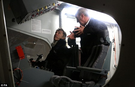 Iron Maiden front-man Bruce Dickinson chats with pilot David Burns in the cockpit. Source: Daily Mail UK
