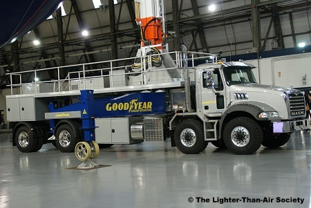 The mobile mast truck is used to secure the blimp when it is on the ground. It travels with the blimp to all destinations where the blimp will land.