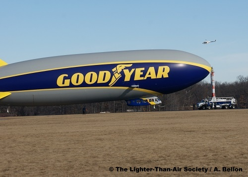 The escort helicopter flies over the new blimp moments before it separates from the mooring mast. Photo: A. Bellon - LTAS