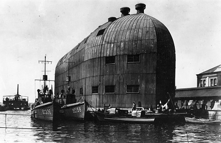 Submarine chasers pictured moored next to a floating hangar built to house the DN-1, the Navy's first airship, at Naval Aeronautic Station Pensacola. Image: Courtesy of National Naval Aviation Museum.