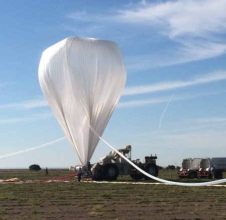 A NASA high-altitude balloon is inflated with helium in preparation for the HySICS science demonstration flight.  Image: NASA Balloon Program Office