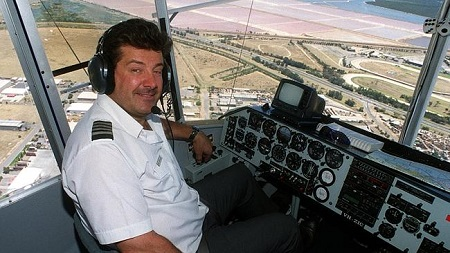 Pilot Captain Mike Nerandzic flying the Goodyear blimp over Adelaide in 1999.  Photo: The Daily Telegraph