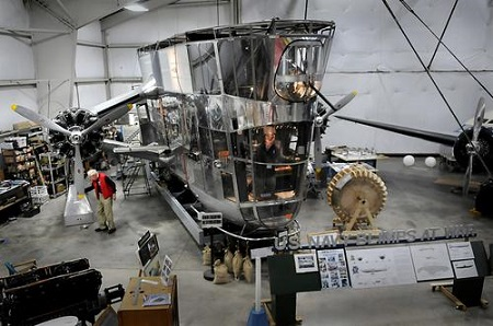 Russ Magnuson of Southington, left, and John Craggs of Marlborough, right, inside the cockpit, work on the Goodyear ZNPK-28 Blimp Control Car that has been undergoing complete restoration by volunteers for the past 21 years at the New England Air Museum.