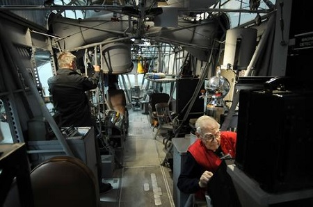 Russ Magnuson of Southington, right, works inside the Goodyear ZNPK-28 Blimp Control Car. When the restoration began, the interior was stripped. Magnuson and his volunteers designed and fabricated accurate reproduction parts to bring the ship back to life.