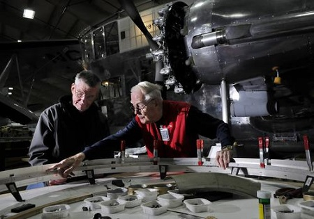 John Craggs of Marlborough, left, and Russ Magnuson of Southington, right, work on fabricating new engine cowlings for the Goodyear ZNPK-28 Blimp Control Car.