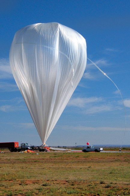The uppermost part of the BalloonSat project´s balloon is filled with helium before it is launched from Fort Sumner on May 31, 2008. It reached an altitude of 120,000 feet. Photo courtesy of NMSU