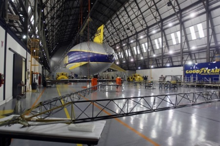 A part of the frame for the the second Zeppelin airship is laid out as Wingfoot One rests in the hangar at the Goodyear Airship base in Suffield Township on Friday. Goodyear has started building the second of three semirigid airships.  Photo: Mike Cardew - Akron Beacon Journal
