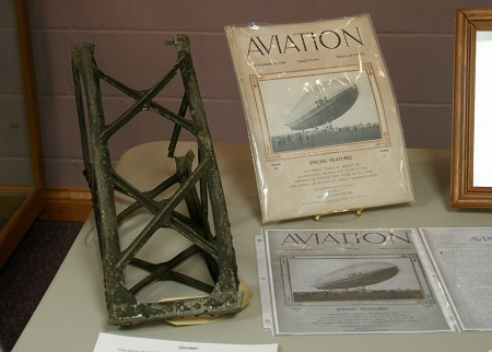 Part of a girder recovered from the crash site and a copy of Aviation magazine published Sept. 10, 1923 reporting on the maiden flight of the USS Shenandoah. Photo: © Alvaro Bellon