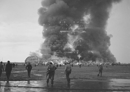 Daily News Photo.  Thick smoke rises from the still-burning shell of the Hindenburg dirigible after it exploded over the Lakehurst airfield. Courtesy of the New York Daily News