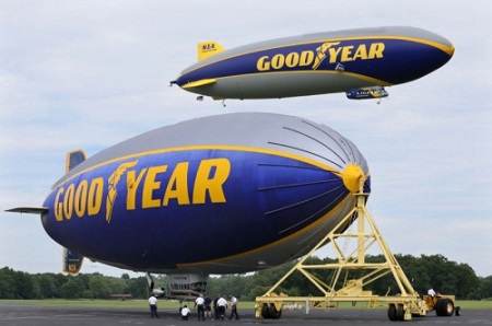 The Goodyear airship Wingfoot One (right) takes flight over the Spirit of Innovation at the company's airship base on Wednesday in Suffield Township.  Photo: Michael Chritton/Akron Beacon Journal