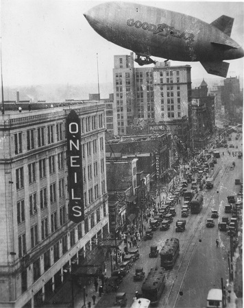 The Pilgrim approaches the O'Neill's Department Store building in downtown Akron as part of a promotional flight.