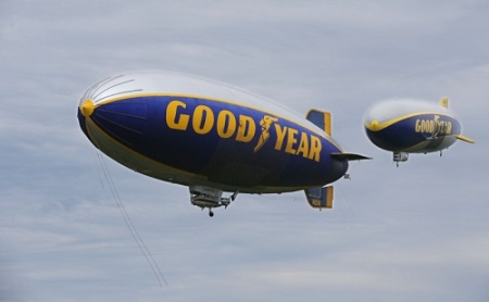 Goodyear airships Wingfoot One (right) and Spirit of Innovation make a pass over the company's airship base on Wednesday in Suffield Township.  Photo: Michael Chritton/Akron Beacon Journal