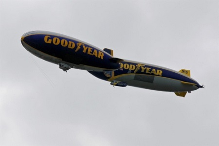 Two Goodyear airships, Wingfoot One (right) and Spirit of Innovation, conduct a tandem flight over the downtown Akron area on Wednesday.  Photo: Ed Suba Jr./Akron Beacon Journal
