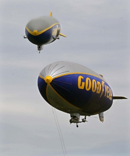 Goodyear airships Wingfoot One (top) and Spirit of Innovation make a pass over the company's airship base on Wednesday in Suffield Township.  Photo: Michael Chritton/Akron Beacon Journal