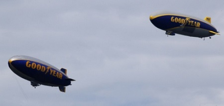 Wingfoot One (right) and Spirit of Innovation, conduct a tandem flight over the downtown Akron area on Wednesday.  Photo: Ed Suba Jr./Akron Beacon Journal