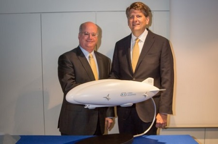 Orlando Carvalho (left) and Rob Binns (right) signed ceremonial certificates to symbolize the strategic alliance between Lockheed Martin and Hybrid Enterprises wherein Hybrid Enterprises is chosen to be the exclusive, authorized reseller of Lockheed Martin's Hybrid Airships. Photo courtesy of Lockheed Martin