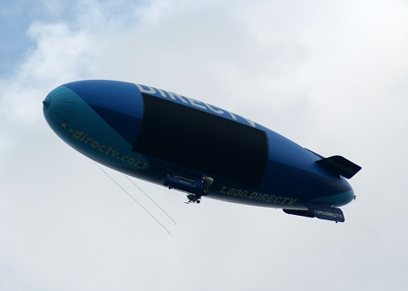 The DirecTV Blimp flies north along Route 8 between Akron and Cleveland, Ohio.