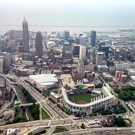 Progressive Field (baseball), the Quicken Loans Arena (basketball), downtown Cleveland Ohio and Lake Erie in the distance. Photo courtesy of DirecTV/Van Wagner Aerial Media on Twitter.
