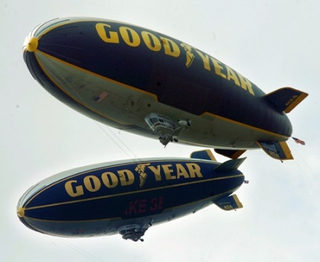 In this June 2006 file photo, The Goodyear Spirit of Innovation (top blimp) and Spirit of Goodyear blimps fly together over downtown Akron. Hoto: Akron Beacon Journal file photo.