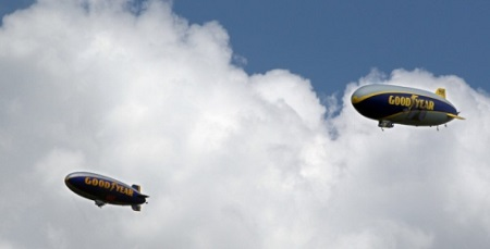 Goodyear Blimp Spirit of Innovation (left) and Goodyear Zeppelin Wingfoot One fly over Stan Hywet Hall for Community Day during its 100th anniversary celebration on Sunday in Akron. Photo: Mike Cardew/Akron Beacon Journal