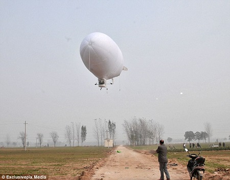 Success: Shi Songbo spent four months building a zeppelin (pictured), which he flew for the first time recently. Photo: Exclusivepix Media/Daily Mail