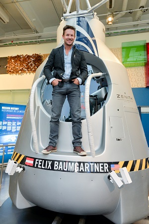 Austrian pilot Felix Baumgartner stands on the capsule used for his historic freefall on October 14, 2012 and now on show at the Ontario Science Centre.  Photo: CNW Group/Ontario Science Centre