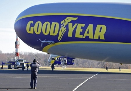 A technician takes a picture on his cell phone of the second new technology Goodyear Airship. Photo: David Dermer - Akron Beacon Journal.