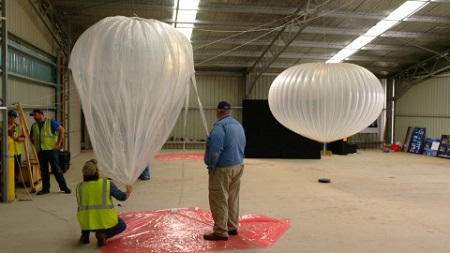 Technicians with NASA's Columbia Scientific Balloon Facility inflate a zero-pressure balloon model as part of a display for the Warbirds Over Wanaka Airshow March 25-27 in New Zealand. A super pressure balloon model is seen in the background. Image courtesy of NASA