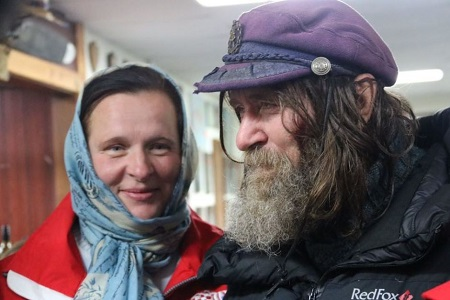 Fedor Konyukhov's wife Irina smiles at her husband as they celebrate his record breaking hot air balloon ride. Photo: Laura Gartry - ABC News