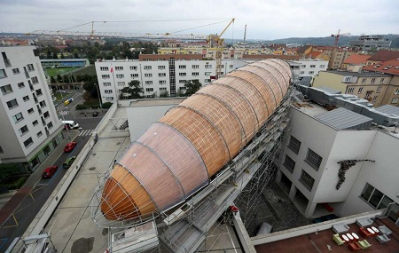 A giant object resembling a zeppelin airship is being installed on the rooftop of an arts center in Prague, Czech Republic. Photo: Petr David Josek, AP