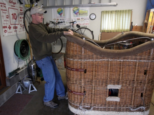 Avid balloon aviator Mike Emich rolls out a hot air balloon basket he stores in his garage in Akron, Ohio. Emich is part of a group building a hydrogen gas balloon. Photo: Michael Chritton/Akron Beacon Journal
