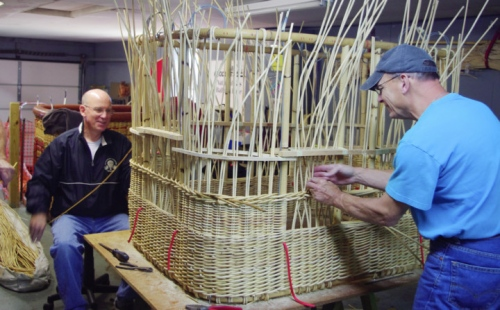 Bert Padelt (right), designer of a gas balloon, and Mike Emch building the wicker basket in Padelt's shop in Bally, Pa. Photo: Joanie Padelt