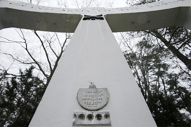 In this Thursday, March 21, 2013 photograph, a monument is seen at a small veteran's memorial park in a neighborhood in Manchester Township, N.J. On the center column is a piece of the airship and a small plaque to the USS Akron airship that went down in a violent storm off the New Jersey coast. The disaster claimed 73 lives, more than twice as many as the crash of the Hindenburg four years later. The USS Akron, a 785-foot dirigible, was in its third year of flight when a violent storm sent it crashing tail-first into the Atlantic Ocean shortly after midnight on April 4, 1933.  AP Photo/Mel Evans, from KIMATV