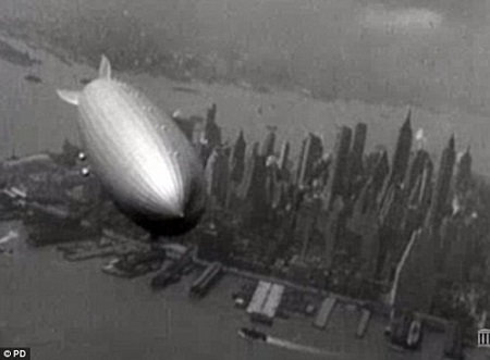 Final flight: The huge zeppelin passes over lower Manhattan in May 1937. Only hours later it would be destroyed in a shocking inferno