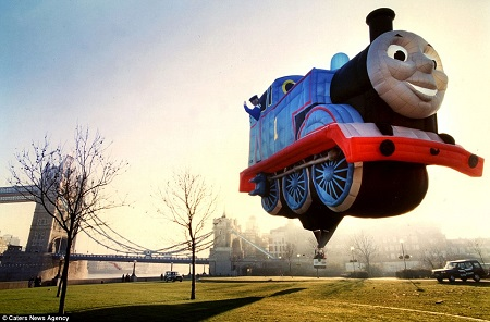 Children's' favorite: A Thomas the Tank Engine balloon designed by Cameron Balloons takes off at daybreak near Tower Bridge in central London
