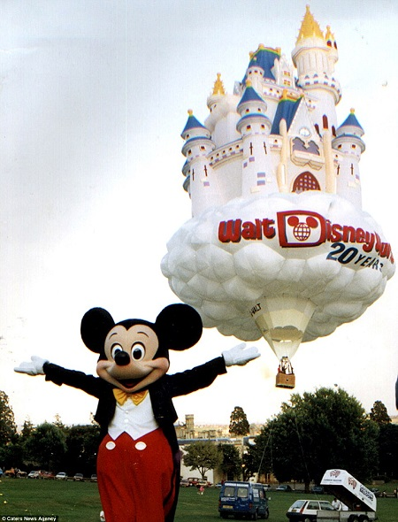 Fairytale: Mickey Mouse shows off a Disney castle balloon designed by the Bristol-based firm