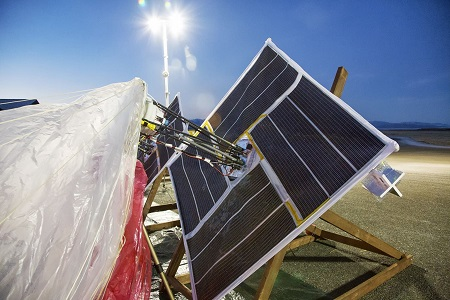 In this June 10, 2013 photo released by Google, solar panels and electronics are prepared for launch in Tekapo, New Zealand. Google is testing balloons which sail in the stratosphere and beam the Internet to Earth.  (AP Photo/Google, Andrea Dunlap)