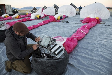 In this June 10, 2013 photo released by Google, Jordan Miceli prepares electronics to launch balloons in Tekapo, New Zealand. Google is testing the balloons which sail in the stratosphere and beam the Internet to Earth.  (AP Photo/Google, Andrea Dunlap)