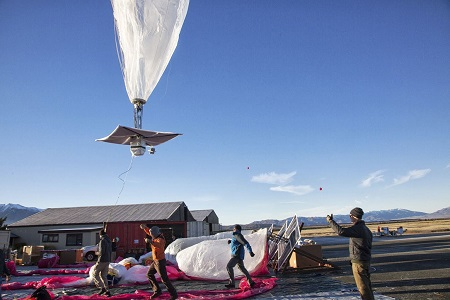 In this June 10, 2013 photo released by Google, a Google team releases a balloon in Tekapo, New Zealand. Google is testing the balloons which sail in the stratosphere and beam the Internet to Earth.  (AP Photo/Google, Andrea Dunlap)