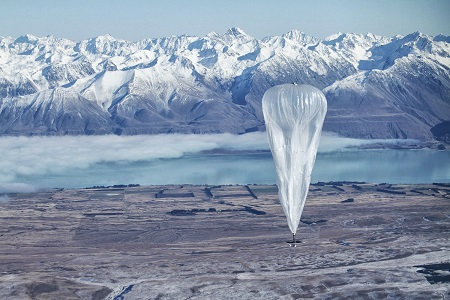 In this June 10, 2013 photo released by Jon Shenk, a Google balloon sails through the air with the Southern Alps mountains in the background, in Tekapo, New Zealand. Google is testing the balloons which sail in the stratosphere and beam the Internet to Earth.  (AP Photo/Jon Shenk)
