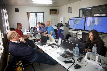 In this June 12, 2013 photo released by Google, Google's team at mission control monitors a balloon launch in Christchurch, New Zealand. Google is testing the balloons which sail in the stratosphere and beam the Internet to Earth.  (AP Photo/Google, Andrea Dunlap)