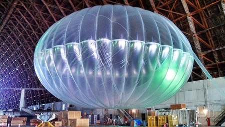 In this March 1, 2013 photo released by Google, a fully inflated test balloon sits in a hangar at Moffett Field airfield, Calif. Google is testing the balloons which sail in the stratosphere and beam the Internet to Earth.  (AP Photo/Google, Andrea Dunlap)