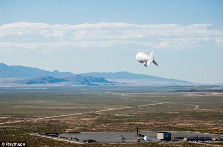 The helium blimps are sent 10,000 feet into the air and then tethered to the ground. Photo: Raytheon/Daily Mail