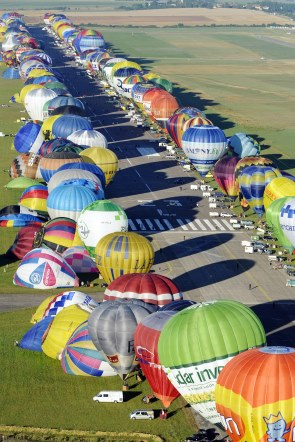 Balloons lined up along the runway in preparation for lift off. Photo: AP Jean Christophe Verhaegen, Pool
